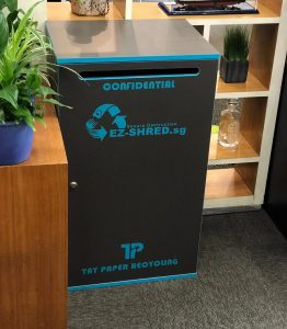 Tay Paper Recycling's dark grey lockable confidential console placed in an office